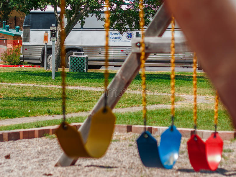 Homeland Security bus parked behind playground stock image