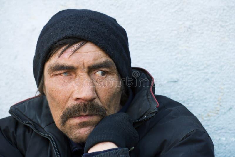 Homeless. Homeless man on a city street stock photo