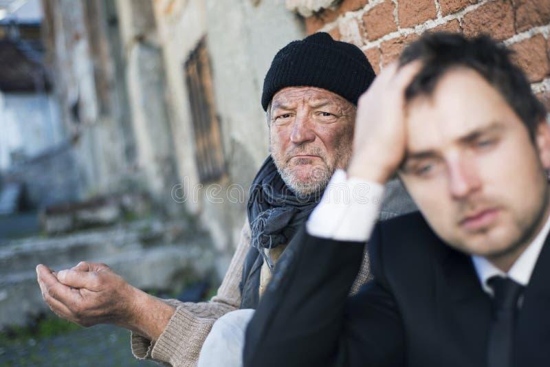 Homeless. Men are begging on the street stock images