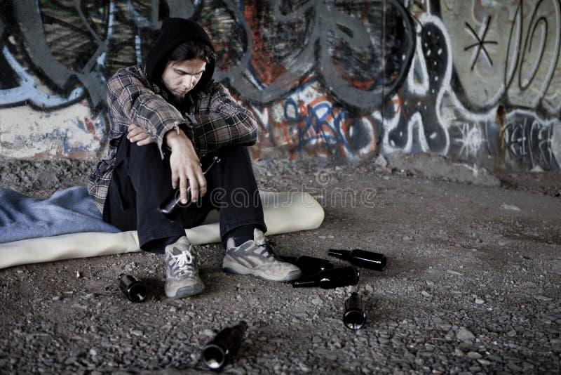 Homeless alcoholic drinking beer stock photos