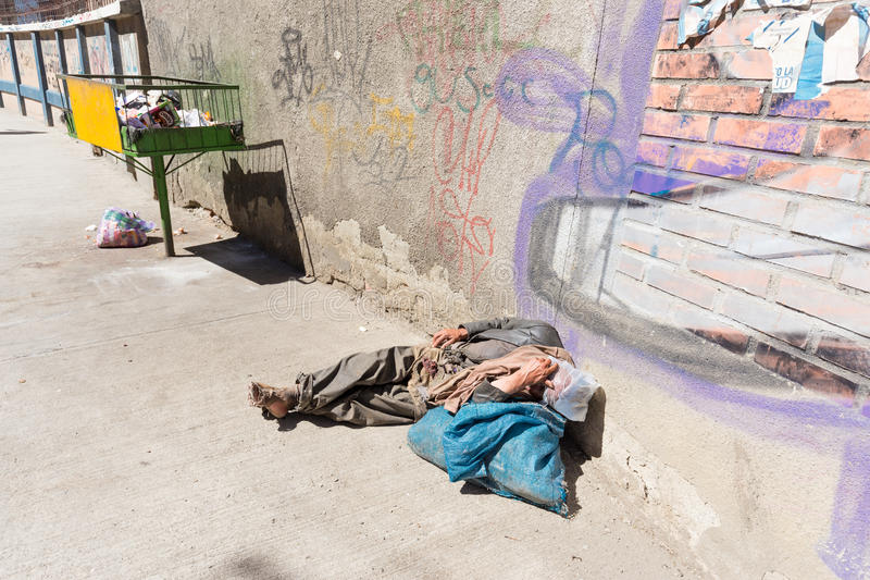 Homeless barefoot lying sleeping street, la Paz, Bolivia. stock images
