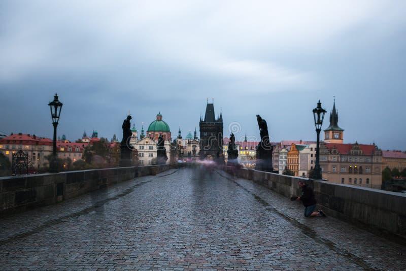 Homeless begs for money on Charles bridge, Prague royalty free stock image