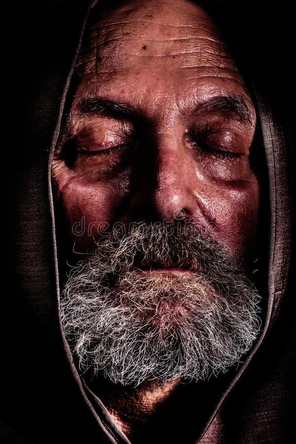 Homeless, a Capuchin friar. poverty and suffering stock photos