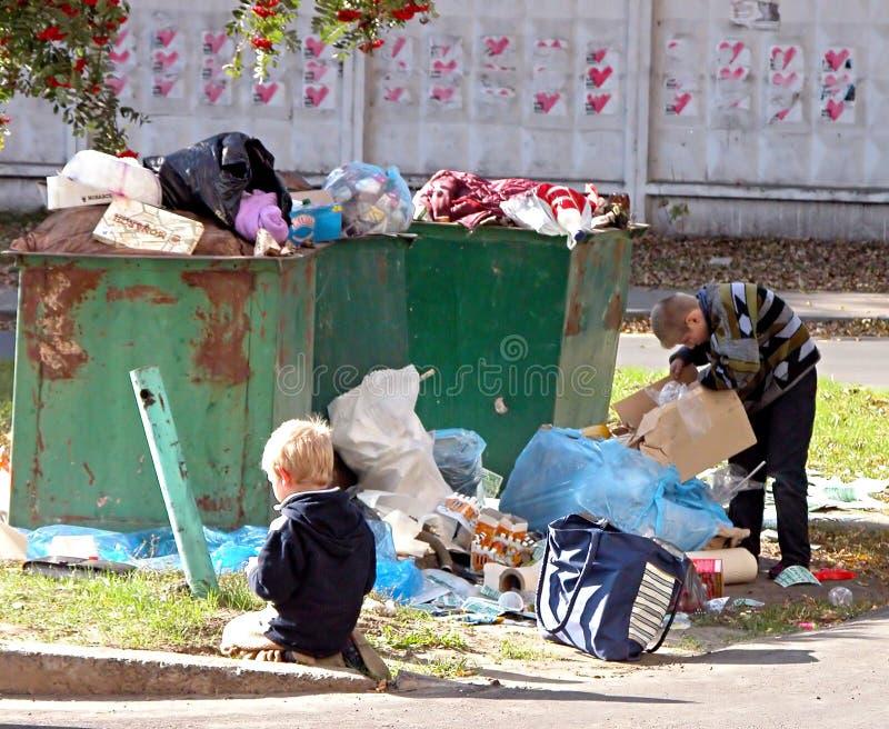 Homeless children. KIEV, UKRAINE - OCTOBER 6: Homeless children at a dump on October 6, 2006 in Kyiv, Ukraine royalty free stock photography