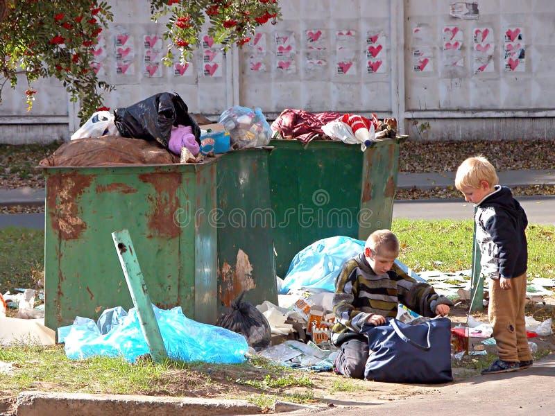 Homeless children. KIEV, UKRAINE - OCTOBER 6: Homeless children at a dump on October 6, 2006 in Kyiv, Ukraine stock photography