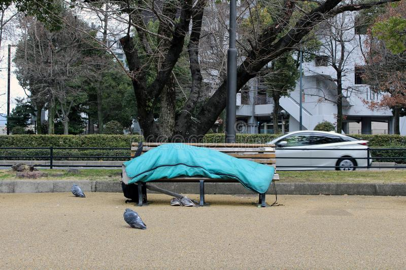 Homeless in the city center of Hiroshima, Japan. Sleeping in the. Park. Taken in Hiroshima, March 2018 stock photography
