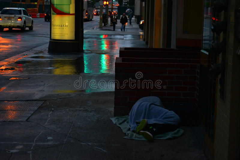 Homeless City. Shot in San Francisco, a homeless man was sleeping off the curb. It reflects there are still poor life in rich city royalty free stock image