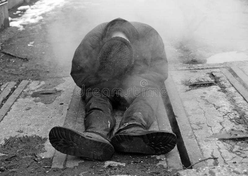 Homeless on the cold streets. A homeless man in the street during winter