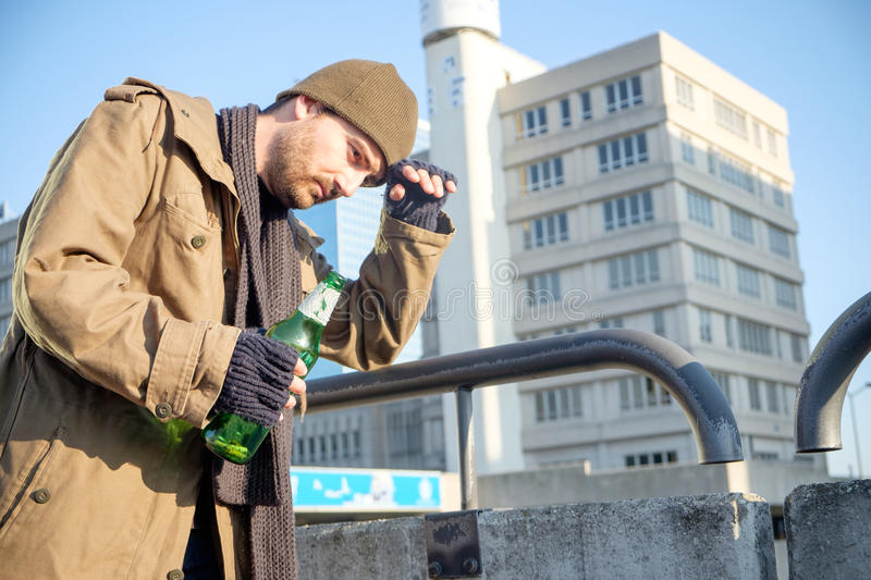 Homeless drunk and alcohol addicted walking alone stock photos