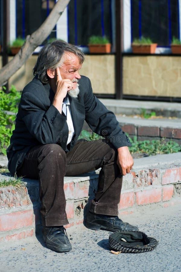 Homeless elderly beggar. royalty free stock images