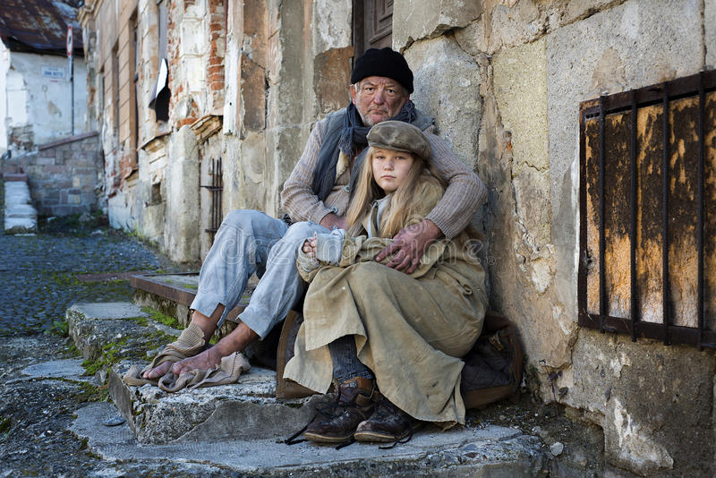 Homeless family. Is begging on the street royalty free stock image