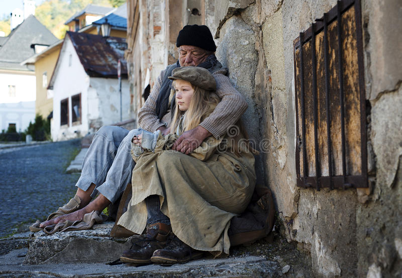 Homeless family. Is on the street being cold stock images