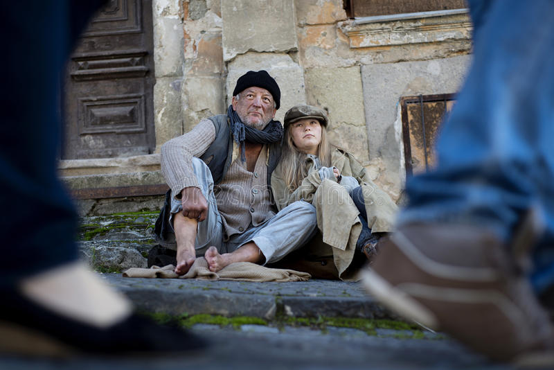 Homeless family. Abandoned people on the street are asking for money royalty free stock photo