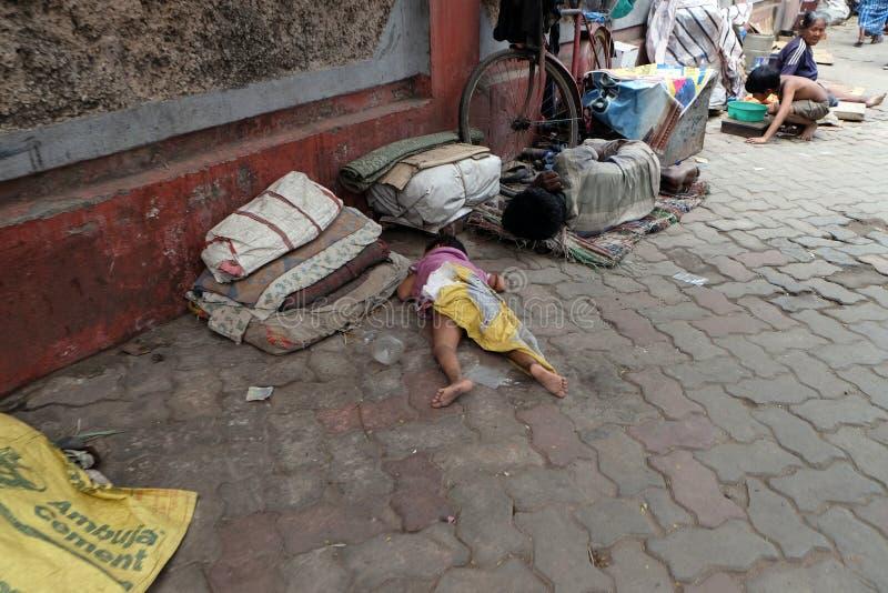 Homeless family living on the streets of Kolkata. India royalty free stock photo