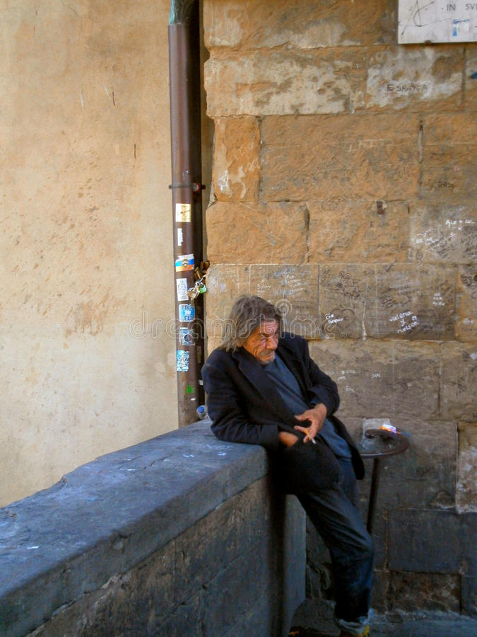 Homeless in Florence. Poor and homeless man from Florence stock photos