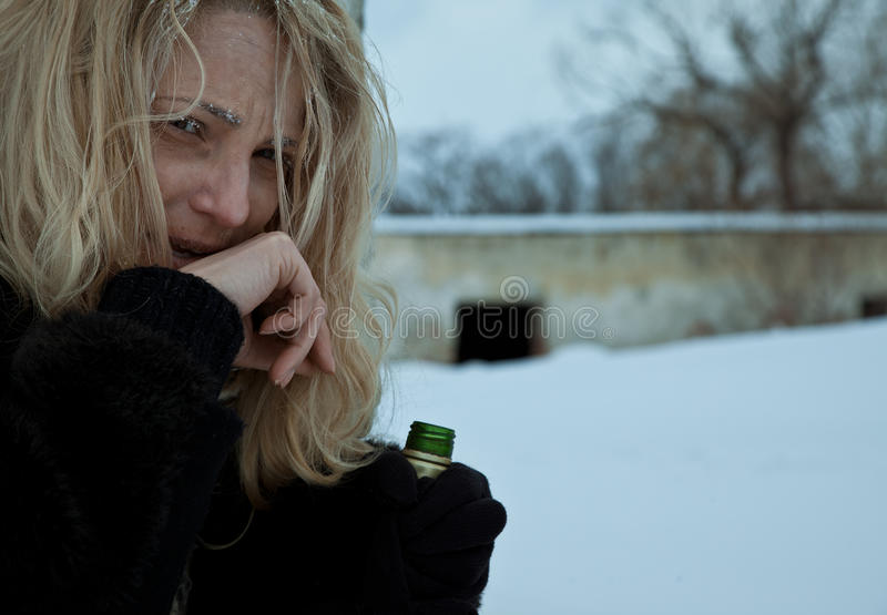 Homeless frozen woman alcohol bottle royalty free stock images