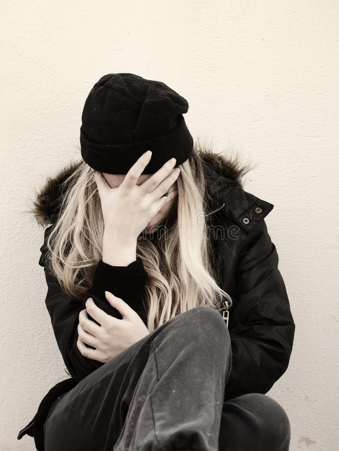 Homeless girl. In winter clothes stock image
