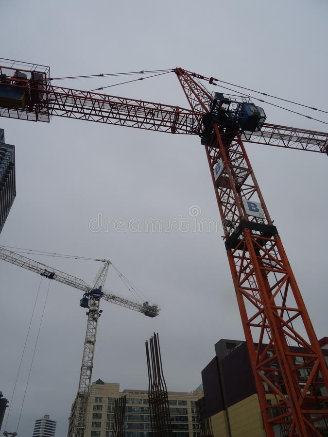 A homeless guy climbed this crane, at Jarvis and Dundas, on 2017-08-02, to protest building luxury condos, not affordable homes -b stock photography