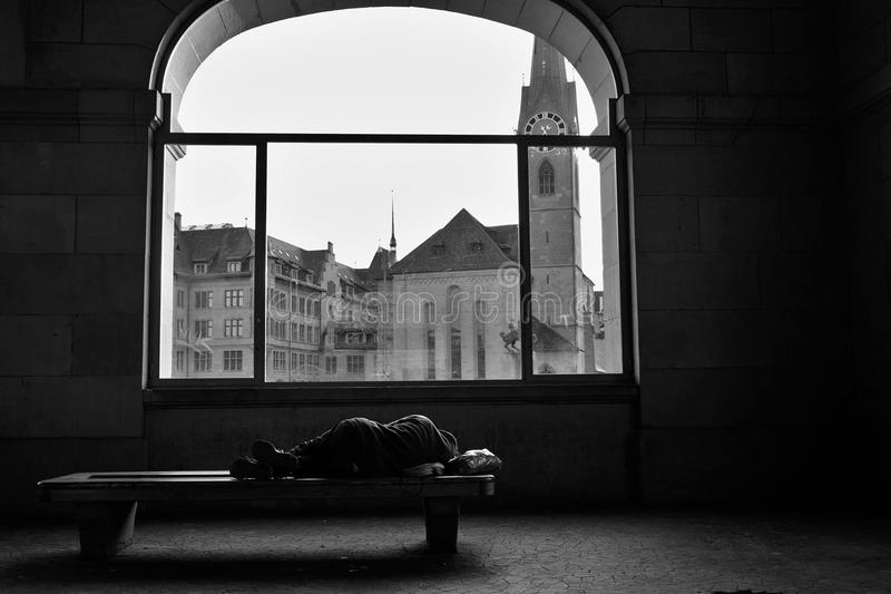 Homeless. Man sleeping on a bench in zürich royalty free stock photography
