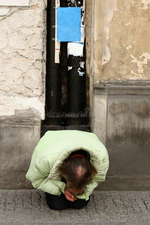 Homeless IV. Homeless man begging on a sidewalk royalty free stock image