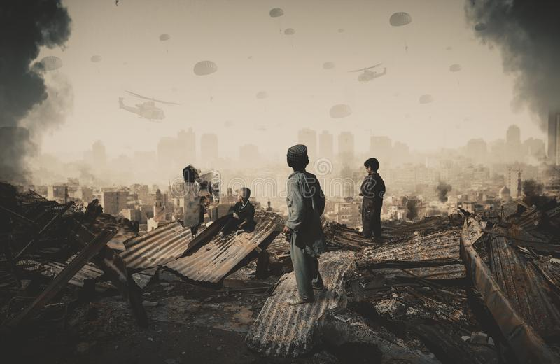 Homeless kids looking at military forces and helicopters stock images