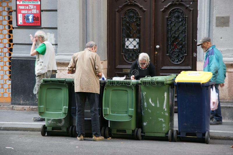 Homeless. Looking for food in waste containers. Budapest royalty free stock images