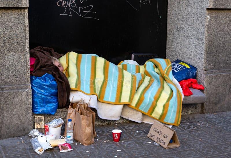 Homeless male getting to sleep stock photo