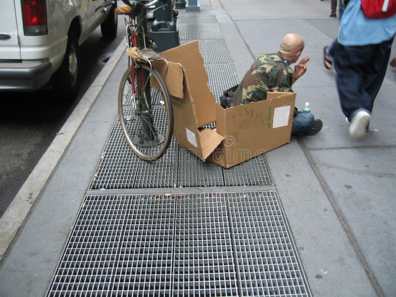 Homeless Man. On sidewalk of New York City royalty free stock photos