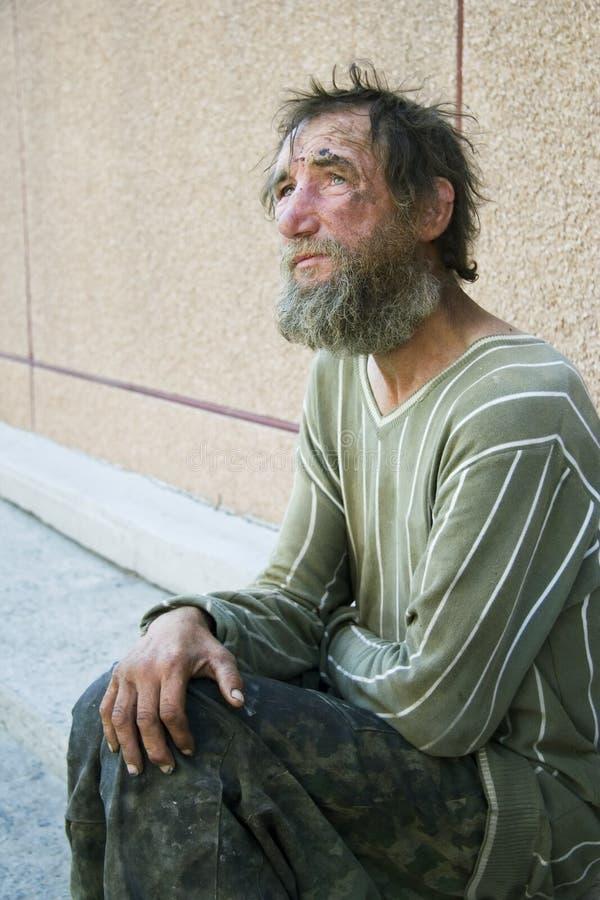 Sad homeless man in depression stock image