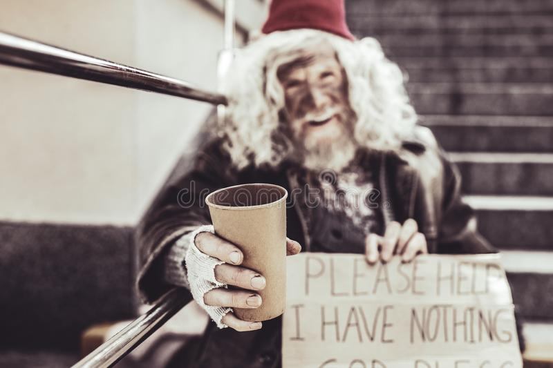 Homeless man appealing hoping for some help with sign. royalty free stock photos