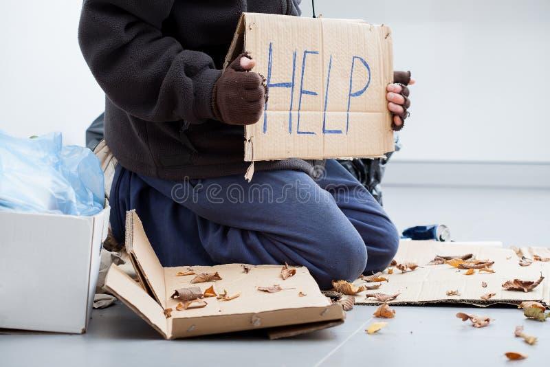 Homeless man begging stock images