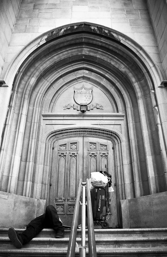 Homeless Man On Church Steps. This is an image of a homeless man captured on the church steps located at the corner of Wilshire Blvd., & Berendo Ave. in Los stock images