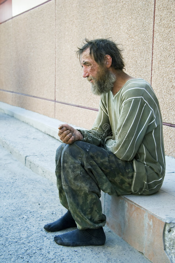Sad homeless man in depression stock images