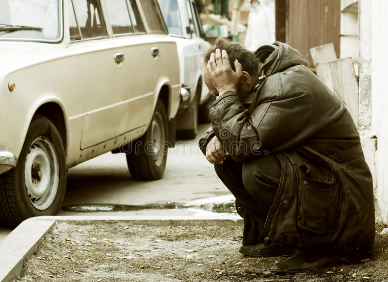 Sad homeless man in depression royalty free stock photography