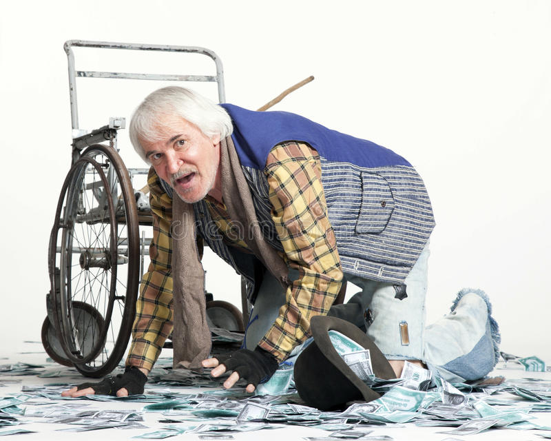 Homeless man with a lot of money. Homeless man with a wheelchair with a lot of money on a white background royalty free stock photo