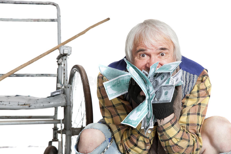 Homeless man with a lot of money. Homeless man with a wheelchair with a lot of money on a white background royalty free stock images