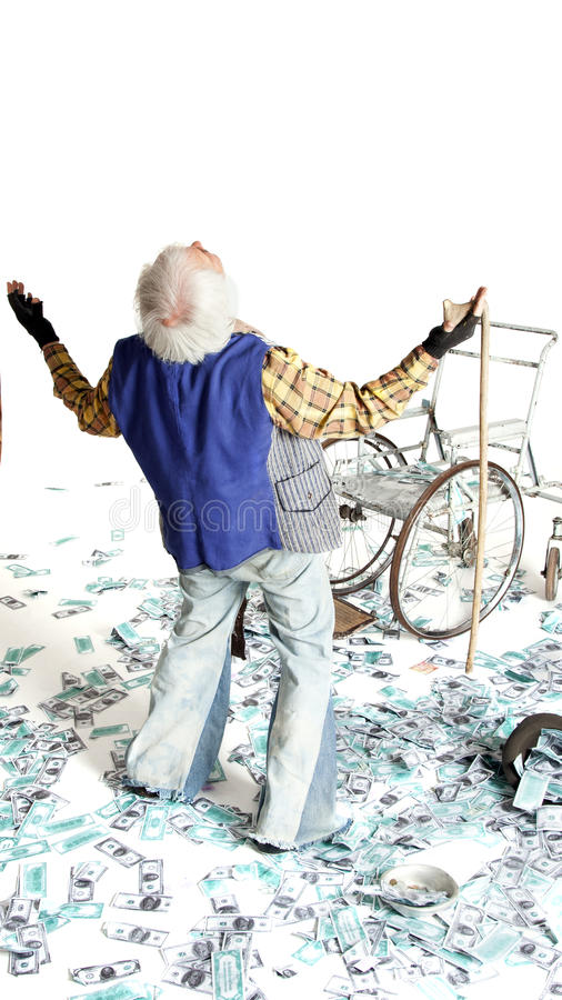 Homeless man with a lot of money. Homeless man with a wheelchair with a lot of money on a white background stock photography