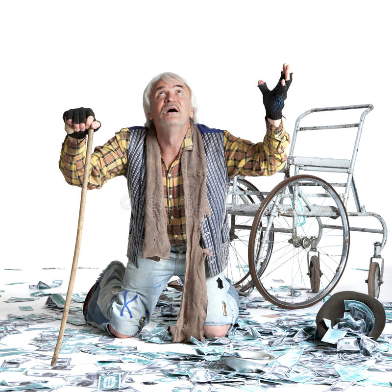 Homeless man with a lot of money. Homeless man with a wheelchair with a lot of money on a white background stock images