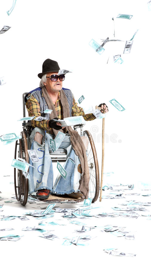 Homeless man with a lot of money. Homeless man with a wheelchair with a lot of money on a white background stock photo