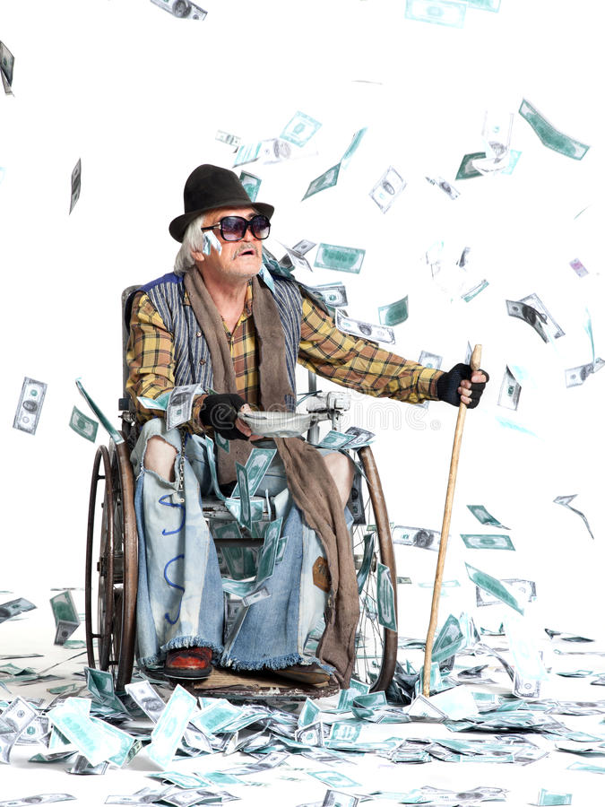 Homeless man with a lot of money. Homeless man with a wheelchair with a lot of money on a white background royalty free stock photos