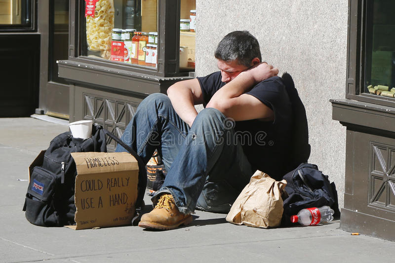 Homeless man at Madison Square in Midtown Manhattan royalty free stock photo
