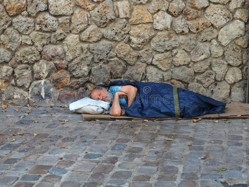 Homeless man in Paris, France royalty free stock images