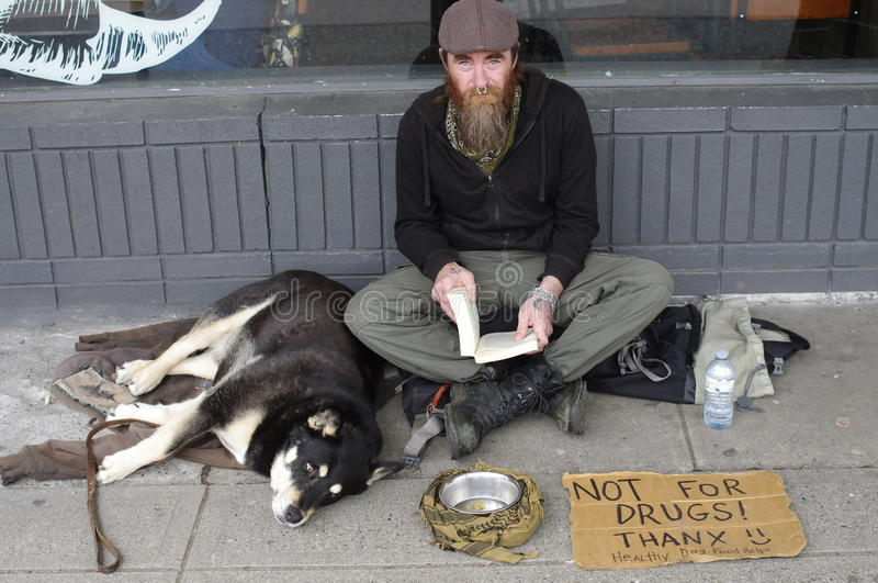 Man begging for money on the street royalty free stock photo
