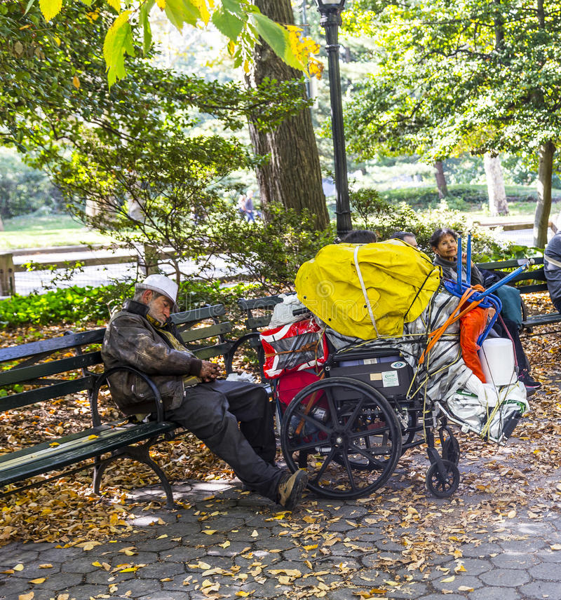 Homeless man sleeping in central park in Manhattan royalty free stock photos