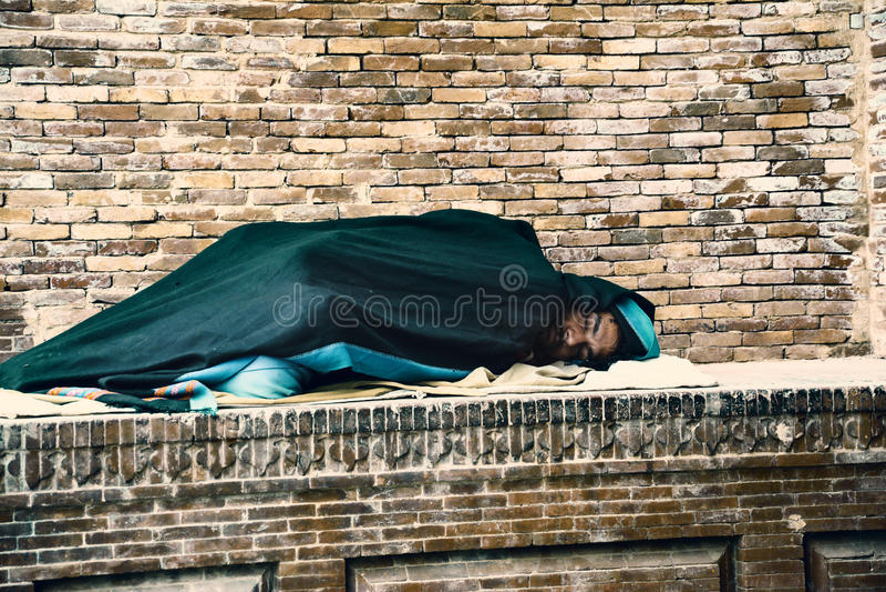 Homeless man sleeping royalty free stock images