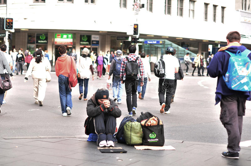 The homeless man begging for money on the busiest street in Sydney near Town hall railway station. stock photo
