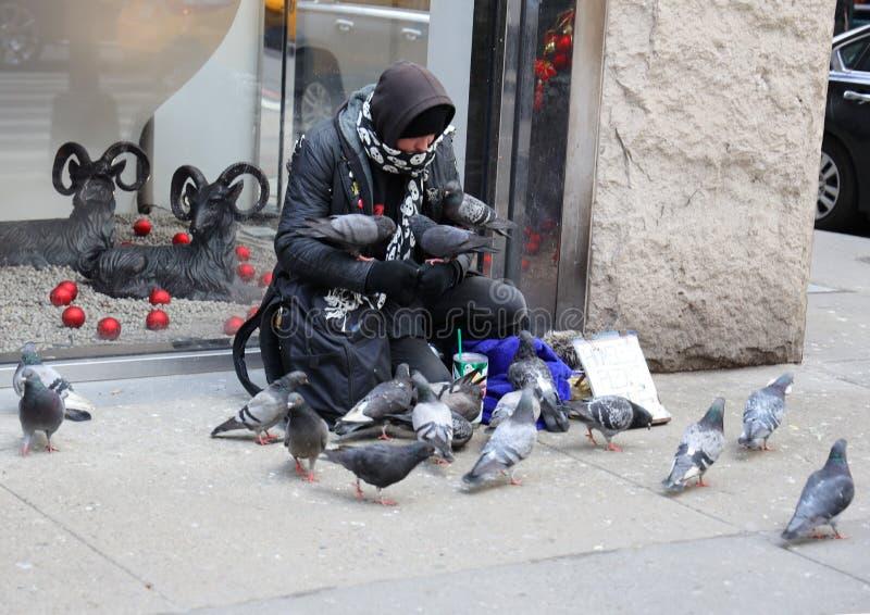 Homeless man at 5th Avenue in Midtown Manhattan. NEW YORK - MARCH 7, 2019: Homeless man at 5th Avenue in Midtown Manhattan stock image