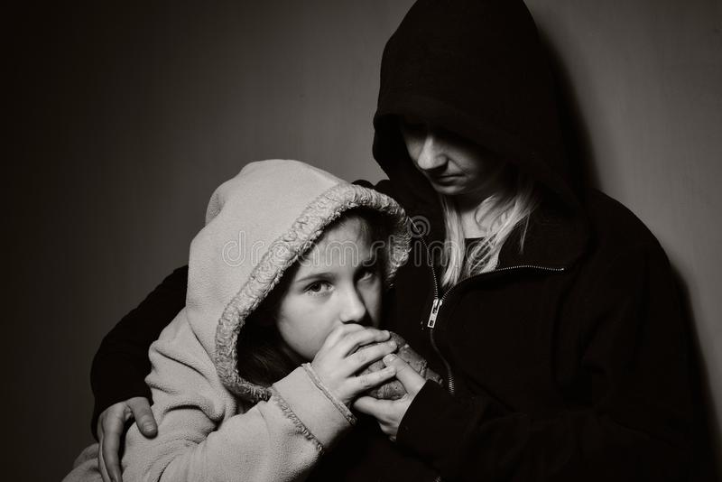 Homeless mother with her daughter. Poor family royalty free stock image