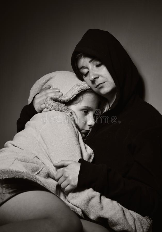 Homeless mother with her daughter. Poor family royalty free stock images
