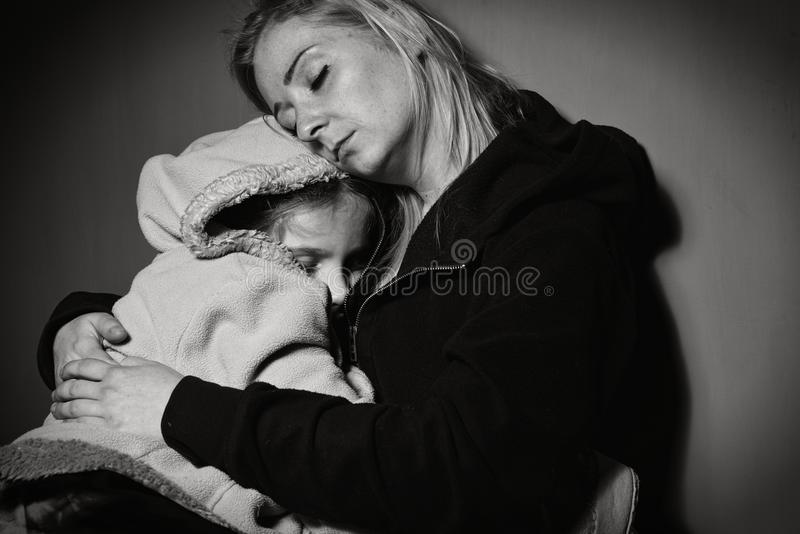 Homeless mother with her daughter. Poor family royalty free stock photo